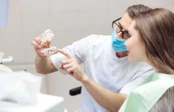 Dentist Consulting with Patient About Bone Grafting